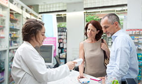 Couple Being Assisted by Pharmacist