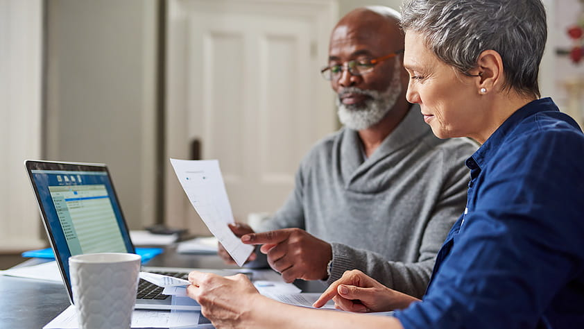 Senior Couple Reviewing Finances Together