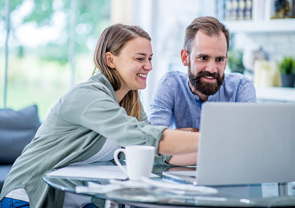 Couple Working On Their Finances on Computer