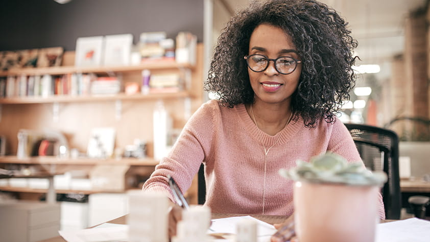 African-American woman working on financial paperwork