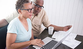 African American Seniors Reviewing Finances Online