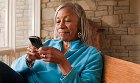 Senior African American Woman on Smartphone