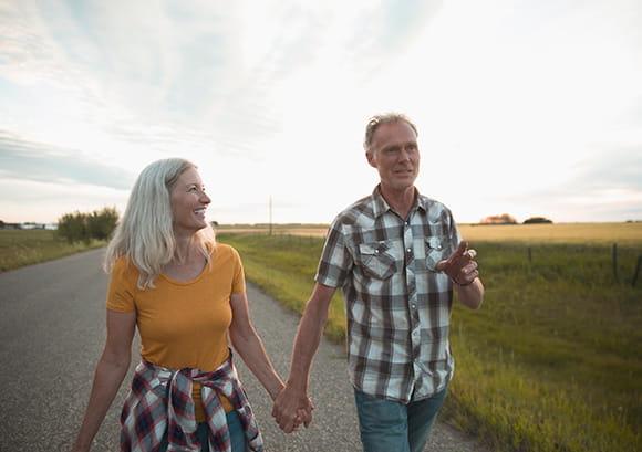 Middle Aged Couple Enjoying Walk Holding Hands