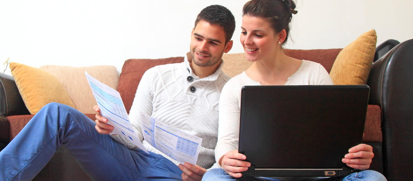 Couple Looking At Financial Statements Together