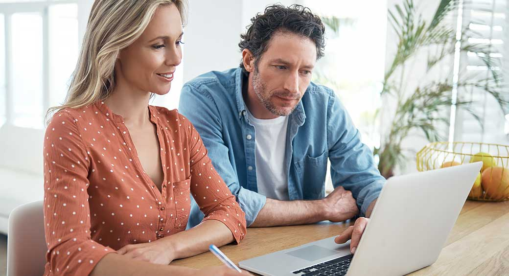 Man and Woman Doing Research About Their Finances to Prepare for The New Year