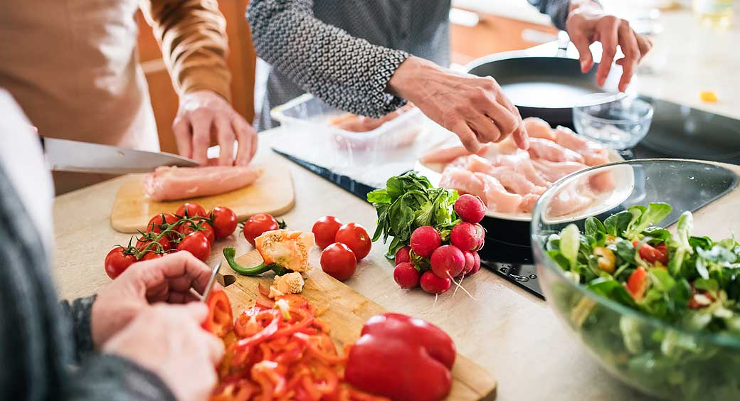 Family Preparing Healthy New Recipe with Chicken, Red Peppers and Cherry Tomatoes