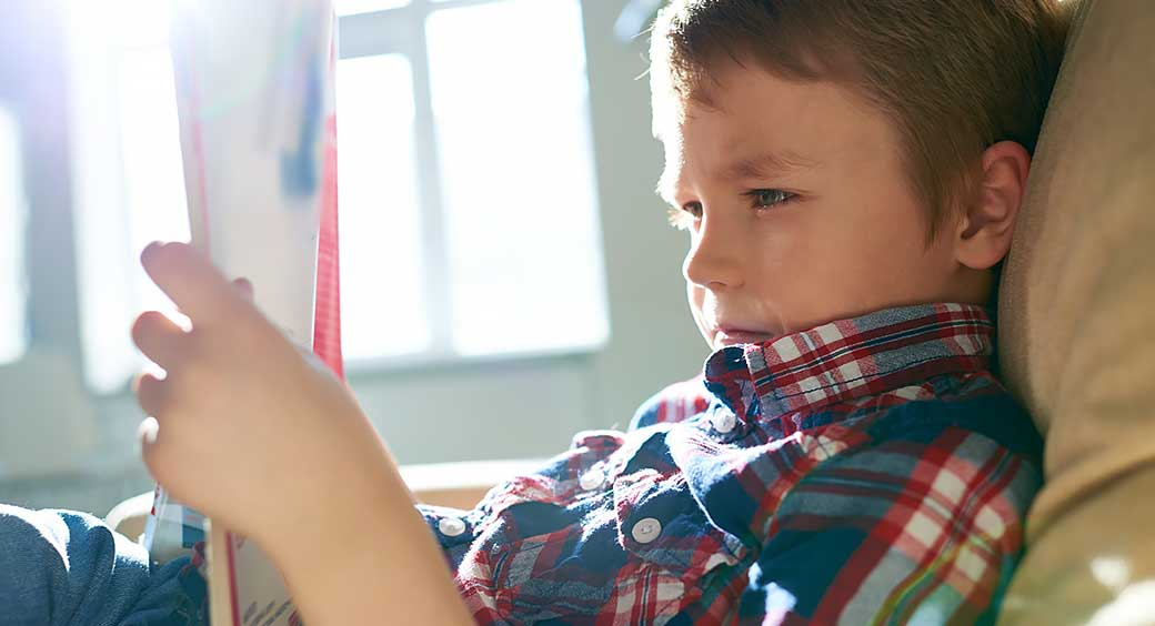 Magazines for Quarantine Hobbies - Young Boy Reading
