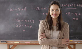 Portrait of a Teacher in Front of a Blackboard
