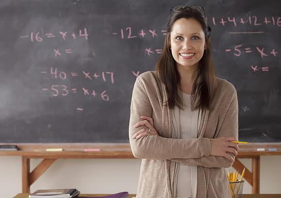 Portrait of a Teacher in Front of a Blackboard