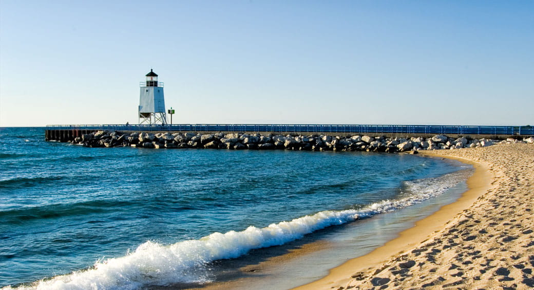 Lighthouse and sandy beach on the Great Lakes in Michigan