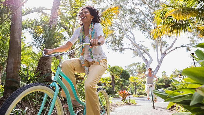 African-American woman riding a bike in a San Diego park