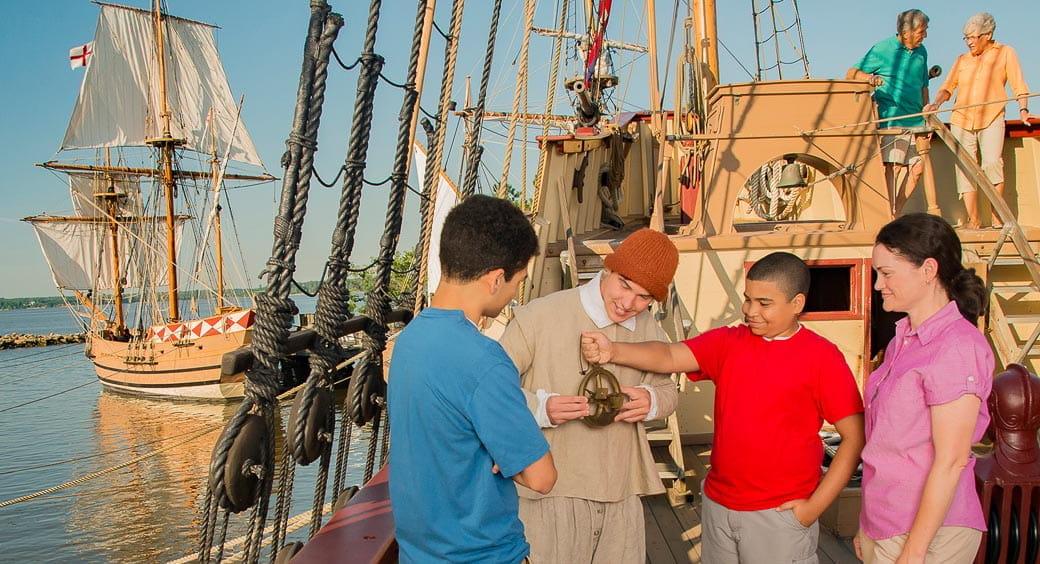 Family exploring a ship at Jamestown, Virginia