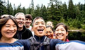 Friends Taking Group Selfie on Lake