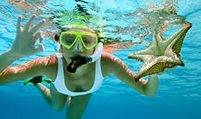 Woman Snorkeling In Ocean