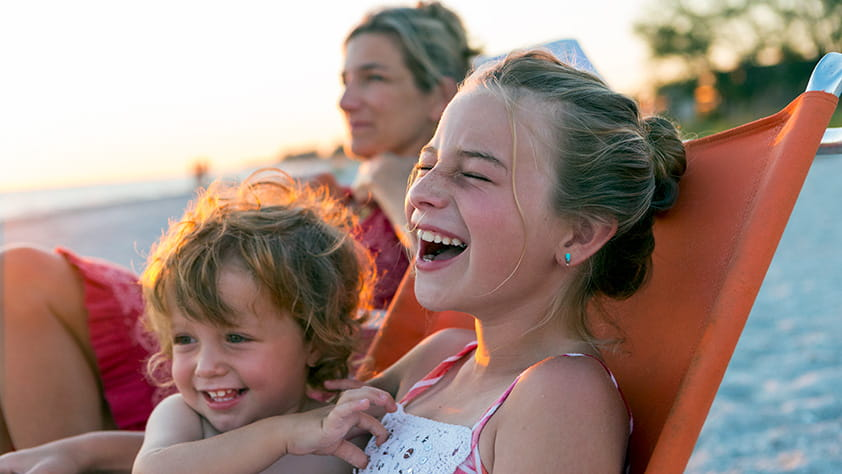 Affordable Last-Minute Spring-Break Ideas - Family Relaxing on the Beach
