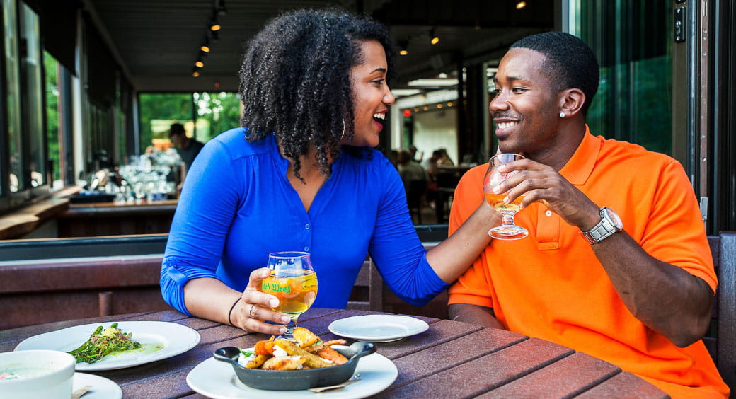 Best Cities for Long Weekends - Happy Couple Dining Out in Asheville, NC