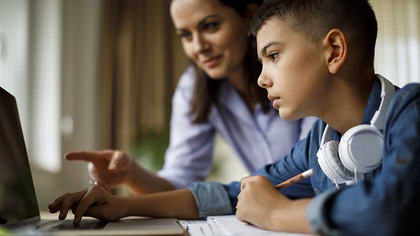 Virtual Field Trips - Mother Helping Teenager with Homework on a Laptop