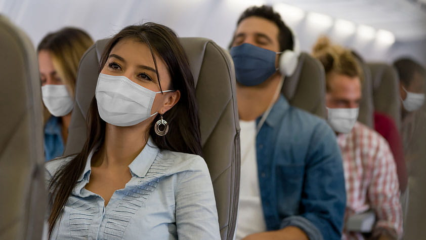 Passengers Wearing Face Masks on a Plane
