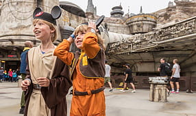 2019's New Theme Park Attractions - Two Young Boys at Galaxy's Edge Disney Theme Park