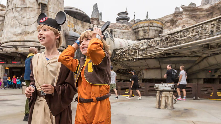 From Star Wars to Spiderman: 2019's New Theme Park Attractions - Two Young Boys at Galaxy's Edge Disney Theme Park