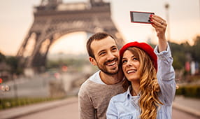 Couple Taking Selfie at Eiffel Tower