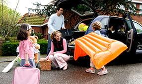 Family Packing Car for Beach Trip