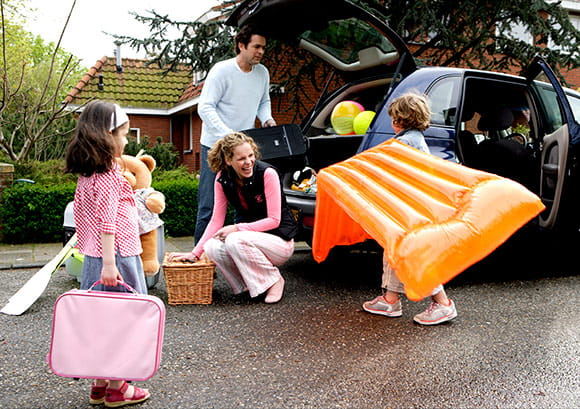 Family Packing Car for Beach Trip