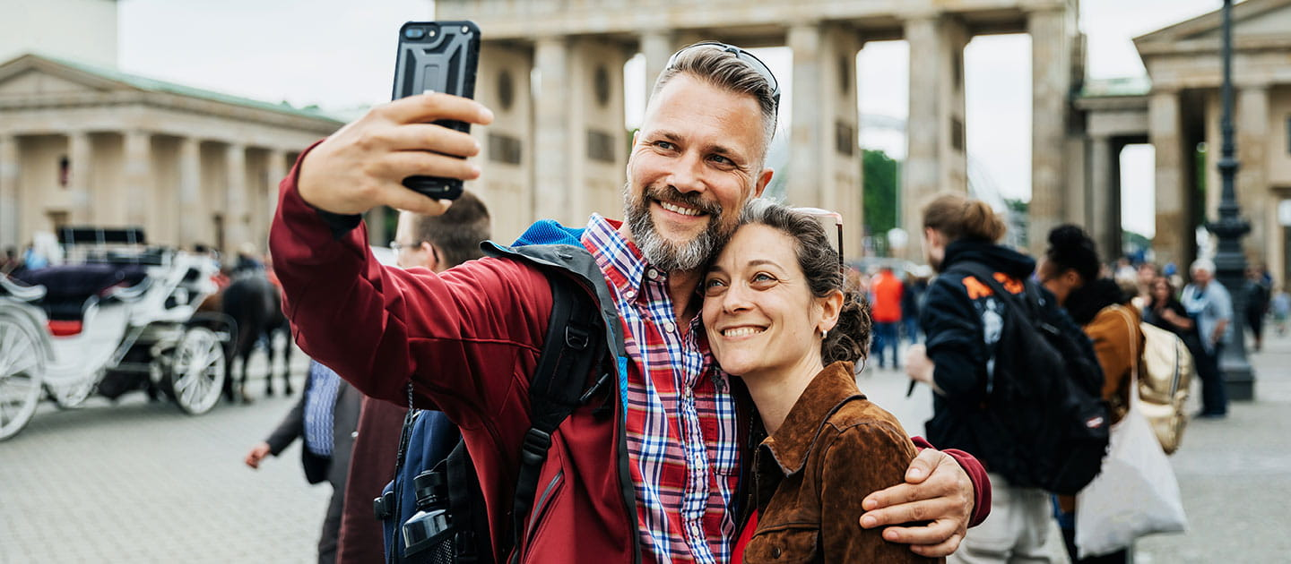 Couple Taking A Selfie Together on Front of Brandenburg Gate in Berlin