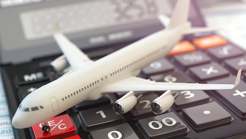 Model Plane on Top of Calculator