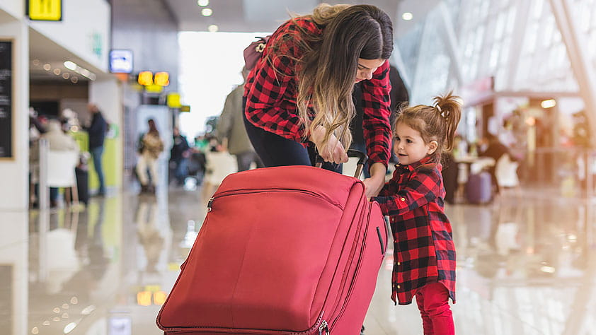 How To Plan a Hassle-Free Holiday Vacation - Mother and Daughter at the Airport