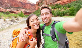 Happy Couple Taking a Selfie While Hiking