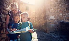 Teacher Helping Children Review Map on Field Trip