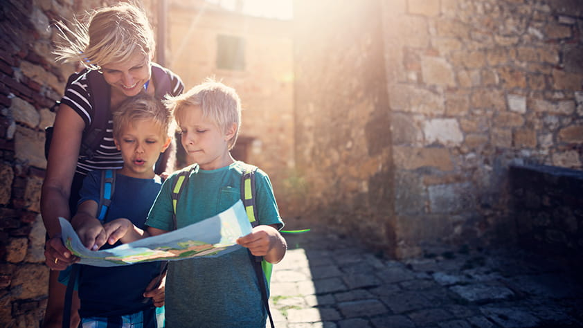 Teacher Helping Children Review Map on Field Trip