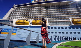 Woman Looking at a Cruise Ship