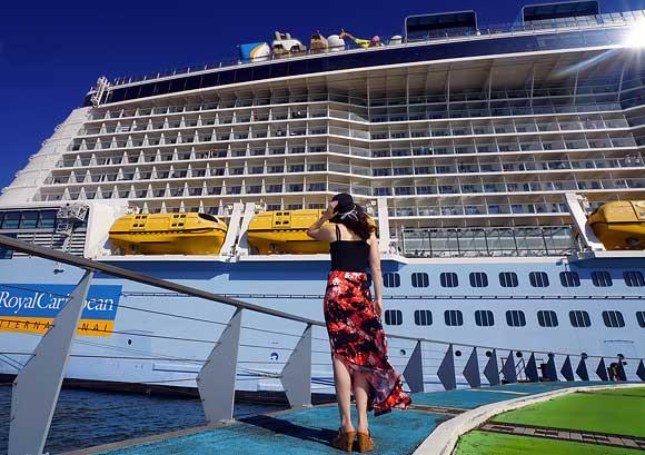 Woman Looking at a Cruise Ship