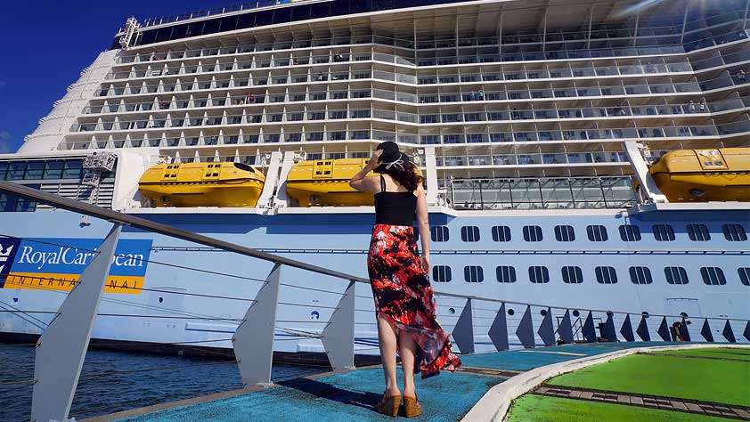 Traveling Solo? Why a Cruise is the Best Way to Go - Woman Looking at a Cruise Ship