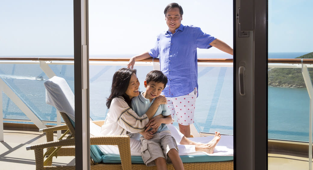 Family sitting on the deck of a cruise ship