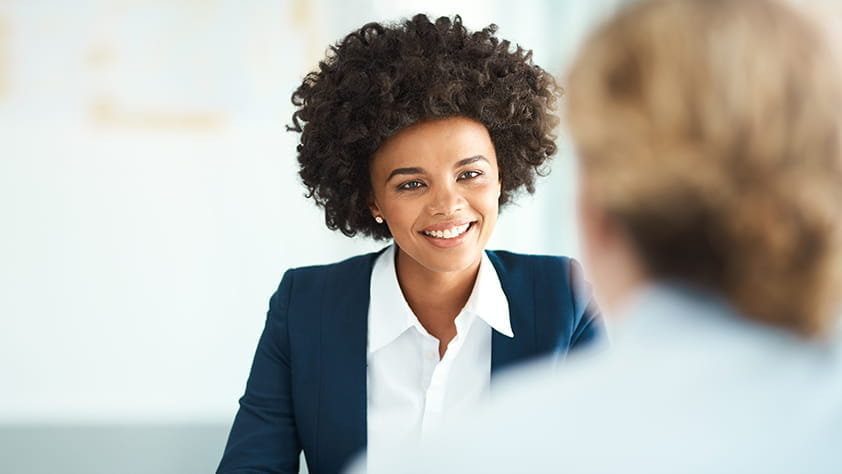 Young woman smiling and participating in an interview