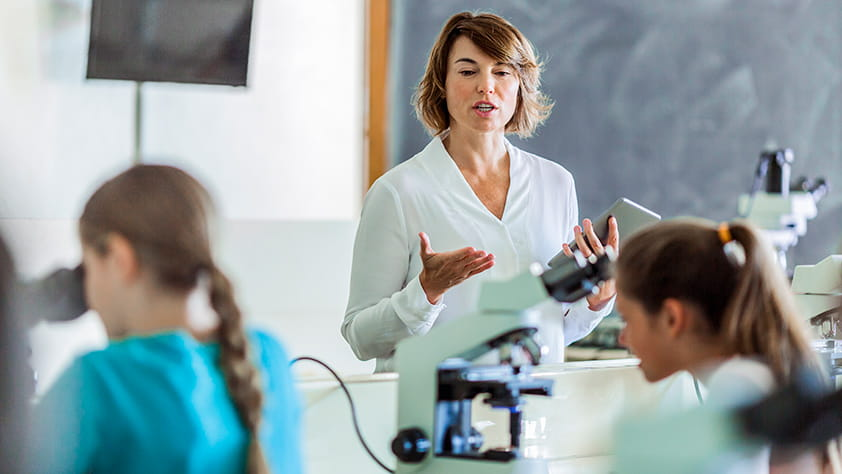 Teacher Instructing Students in Lab