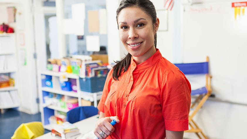Portrait of a teacher smiling in a classroom