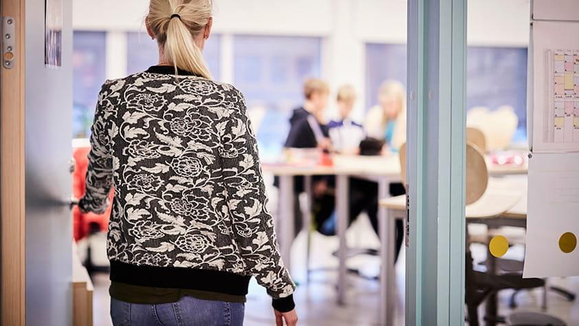 Woman Walking Into Office