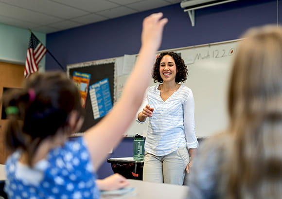 Teacher standing in front of her class