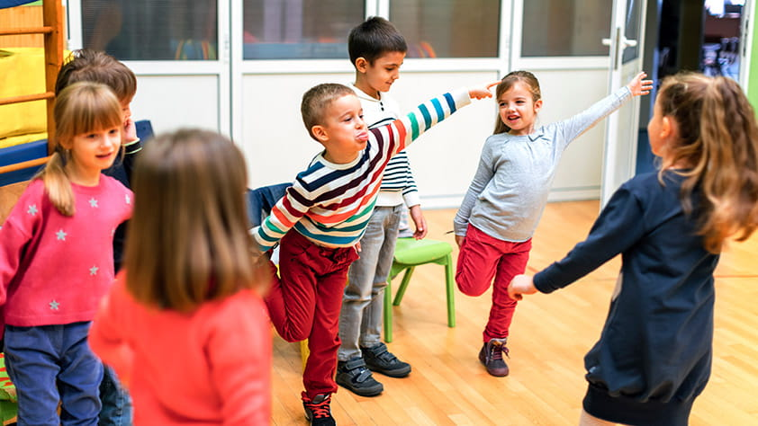 Group of young children exercising in their classroom