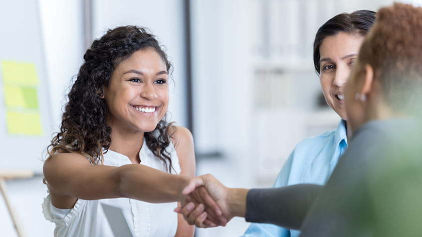 Teacher Candidate Shaking Hands at an Interview