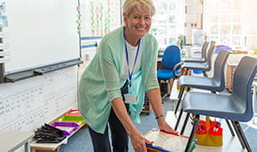 School Teacher Preparing for Day in Classroom