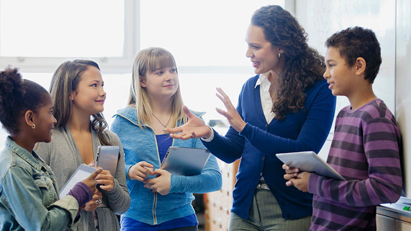 Teacher explaining a lesson to her middle school students