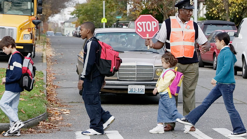 4 Ways to Navigate Back-to-School Safely - Crossing Guard Helping Children Cross the Street