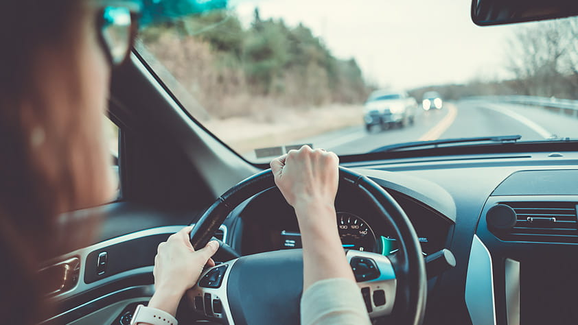 Defensive Driving Tactics to Protect Yourself on the Road - Woman Behind the Wheel of a Car