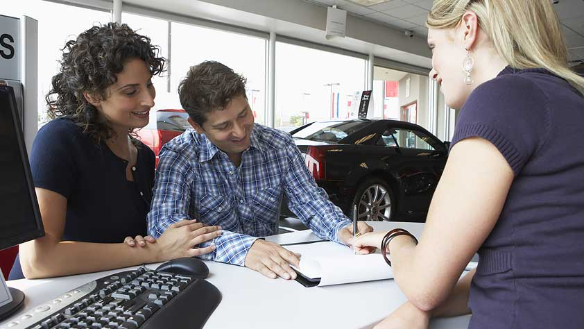 How to Buy a Car Quickly - Couple with Car Saleswoman Signing Paperwork