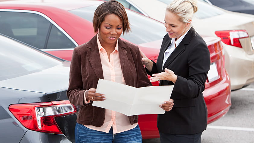 Woman Reviewing Auto Purchase Contract